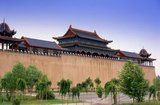 The Kings of Hami were hereditary Uighur rulers who paid tribute to China. The last king of Hami, Maqsud Shah died in the mid-1930s. Nine generations of kings of Hami are buried here.<br/><br/>  The ancient oasis settlement of Hami, also known in Uighur as Kumul, sits in a fault depression about 200m below sea level and, like nearby Turpan, experiences extremes of temperature ranging from a scalding 45C in summer to a freezing -30C in winter.<br/><br/>  Silk Road caravans stopped in Hami for its fresh springs and water runoff brought by karez underground canals from the distant Karlik Tagh, and for its fabled fresh fruit – Hami melons are famous across China today. More importantly still, they stopped here because there simply was nowhere else to go. Hami still remains the only significant oasis in the Gashun Gobi, an essential stop on the long and difficult desert stages between Anxi and Turpan.
